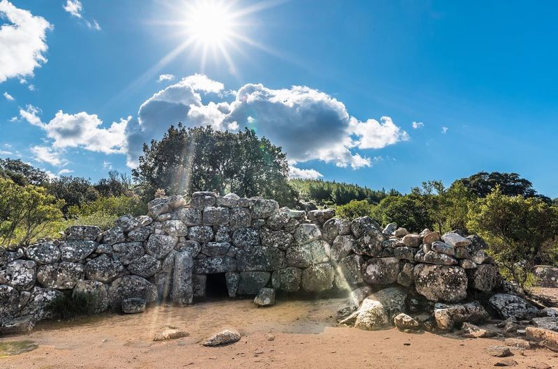 Rock - Object Sunlight Sun Sky Sunbeam Cloud - Sky Nature Sunny Day Outdoors Old Ruin No People Blue Ancient Landscape Beauty In Nature Tree Architecture Ancient Civilization