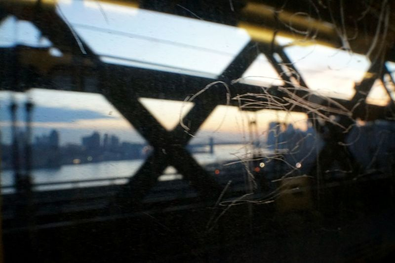 View From The Window... Bridge - Man Made Structure Urban Exploration Mta Nyc Transit Skyscraper Manhattan Urban Skyline Cityscape Sunset_collection East River, NYC Scratched Glass Outoffocus Silouette & Sky View From Train Window Williamsburg Bridge Break The Mold Lost In The Landscape Stories From The City