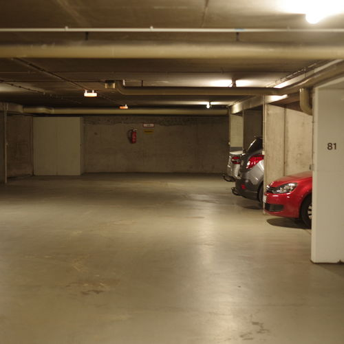 Mode Of Transportation Transportation Illuminated Land Vehicle Parking Lot Car Motor Vehicle Indoors  Parking Garage Lighting Equipment Architecture Basement Ceiling Architectural Column Flooring Subway Empty No People Fluorescent Light Public Transportation Light Garage Concrete