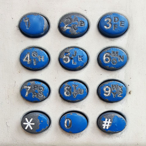 A public Payphone is a rare thing to encounter these days, and those which do remain are in poor condition. Arrangement Blue Close-up Digits Keypad Phone Public Phone Telephone White Background Worn Out