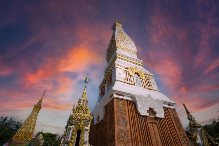 The pagoda of wat phra that panom temple in nakhon phanom in cloudy blue sky day with sunlight