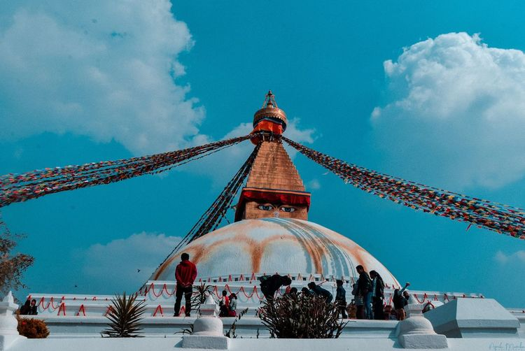 Boudhanath Stupa EyeEm Selects Snow Cold Temperature Winter Blue Arts Culture And Entertainment Sky Architecture Carousel Rollercoaster Carousel Horses Place Of Worship Amusement Park Traveling Carnival Merry-go-round Chain Swing Ride Coney Island Amusement Park Ride Fairground Ride Ride Church Mosque Catholicism Fairground Christianity Ferris Wheel Historic Cathedral Spinning Spirituality