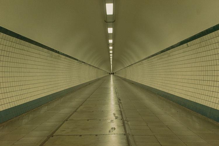 Shiny Pathway At Illuminated Tunnel