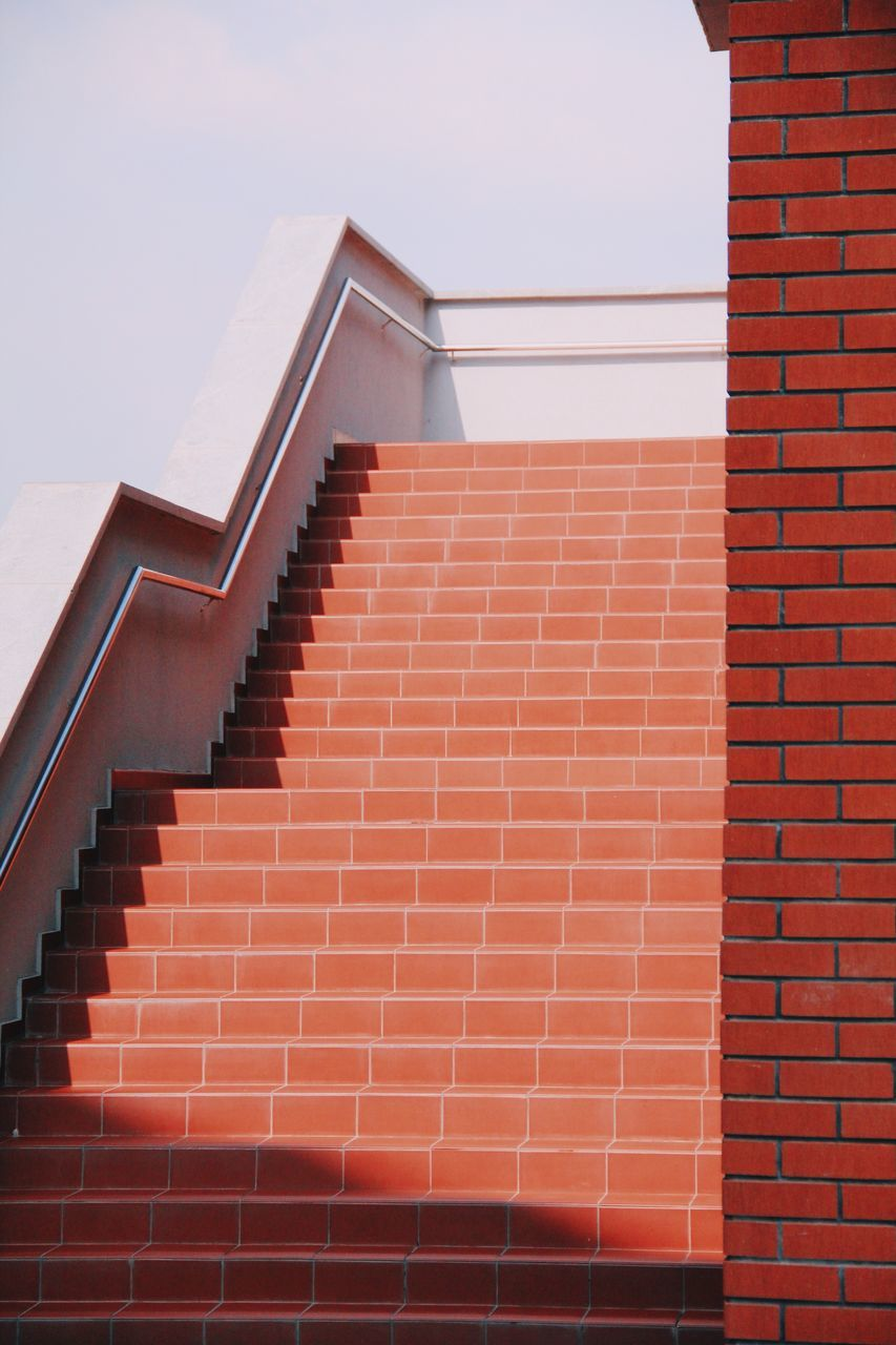 architecture, built structure, building, staircase, building exterior, brick, steps and staircases, pattern, no people, brick wall, day, nature, sky, wall, low angle view, roof, red, sunlight, roof tile, design