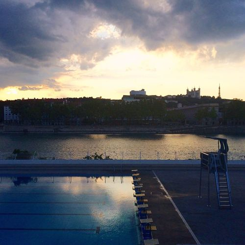 Water Sky Reflection Cloud - Sky Sunset Outdoors Architecture No People Swimming Pool Nature Horizontal Day Lyon My Point Of View Square Format Lovers Sunset_collection Sunset Silhouettes Square Format IPhoneography
