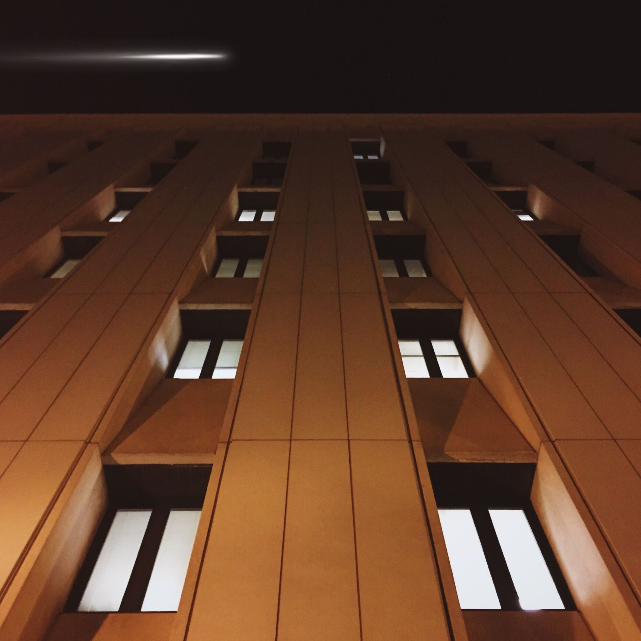 architecture, low angle view, built structure, building exterior, window, building, city, illuminated, residential building, no people, modern, glass - material, night, residential structure, sky, outdoors, office building, directly below, apartment