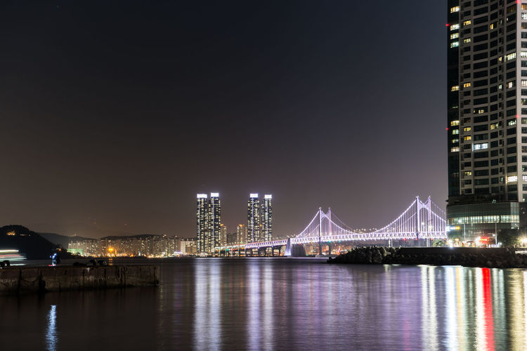 Architecture Built Structure Night Connection Bridge Illuminated Water Bridge - Man Made Structure Waterfront Building Exterior City Sky River Reflection Engineering Transportation Travel Destinations Nature Office Building Exterior Outdoors Skyscraper Modern Cityscape Light Bay