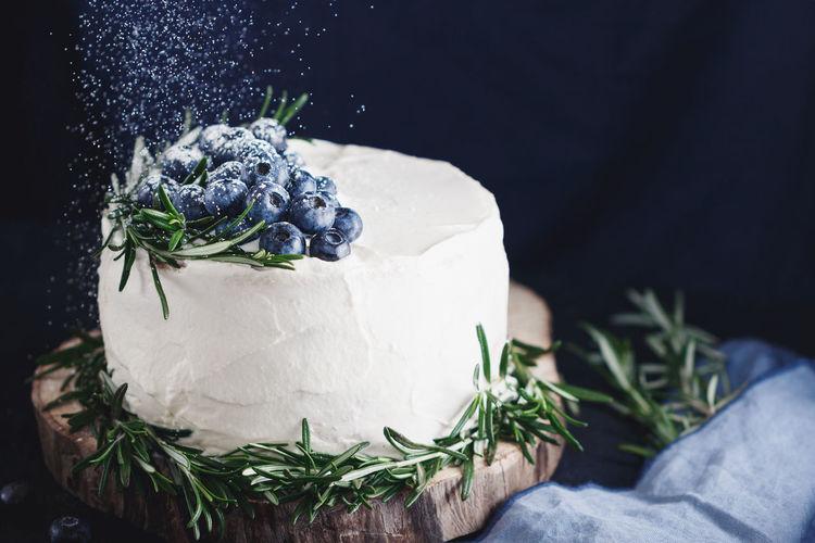 Close-up of cake on tree stump