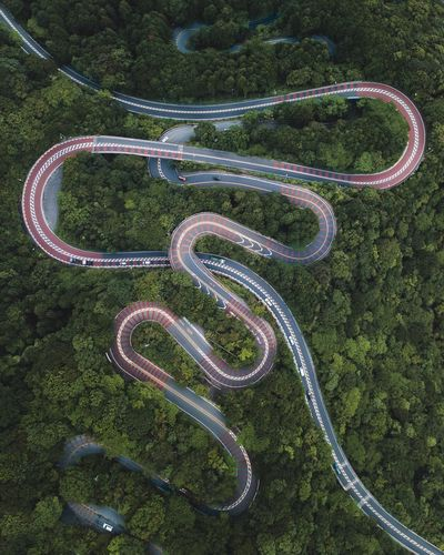 @itchban / www.itchban.com Aerial View Road Curve Winding Road High Angle View Asphalt Transportation Landscape No People Car Nature Road Trip Scenics Day Outdoors Fame Eyesight Beauty In Nature Tree Planet Earth