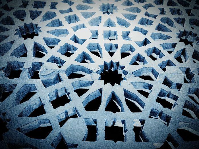 Beautiful complicated wall Venthole Pattern of Islamic Art in a Masjid. Mosque Islamic Design Fine Art Photography