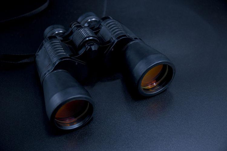 High angle view of binoculars on black background