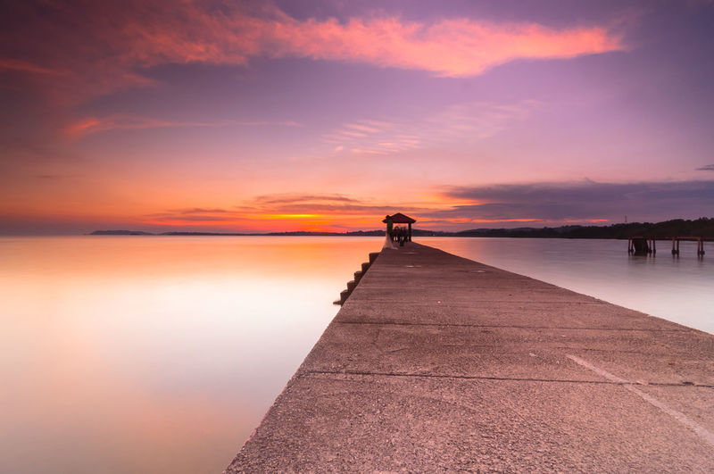 Surface Level Of Pier Against Calm Sea At Sunset In Port Dickson, Malaysia