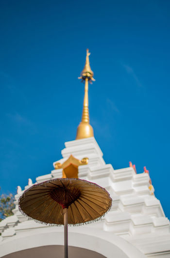 Built Structure Sky Architecture Low Angle View Clear Sky Belief Place Of Worship Religion Building Spirituality Blue Nature No People Travel Destinations Day Building Exterior Umbrella Parasol Tourism Outdoors Spire