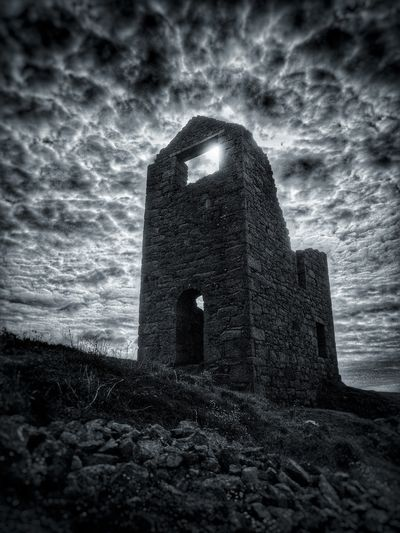 Poldark country Architecture Built Structure Old IPhoneography Building Exterior Coastal Feature Majestic Poldark Tourism Rock - Object Cloud - Sky Sky Auto Post Production Filter Weathered Damaged Tower Outdoors Travel Destinations Ruined Cloudy History Medieval Tranquility Fortress No People Welcome To Black Black And White Friday Black And White Friday The Graphic City