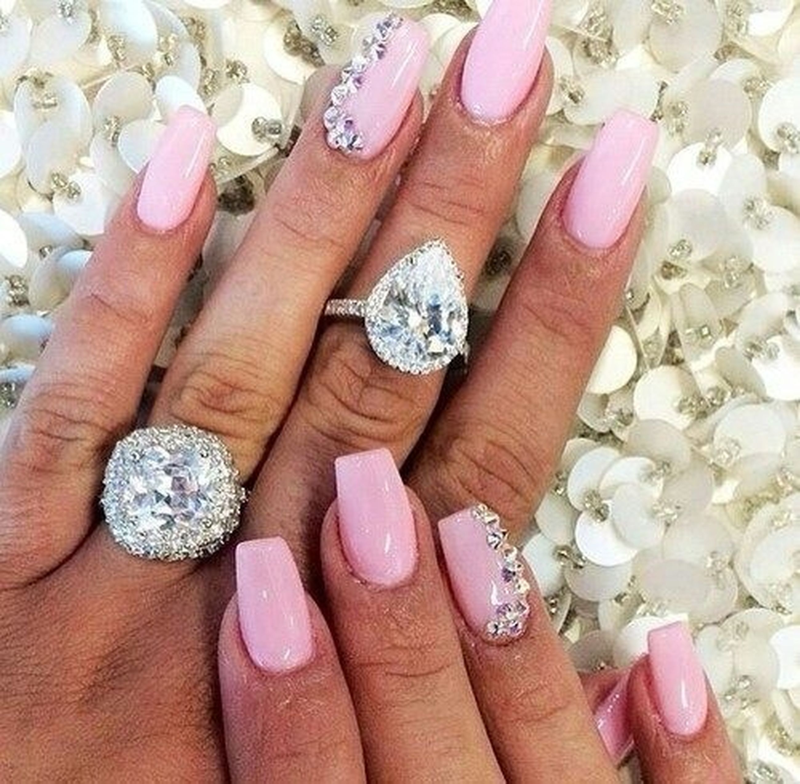 person, part of, holding, human finger, cropped, close-up, indoors, high angle view, jewelry, freshness, ring, personal perspective, unrecognizable person, fragility, palm, nail polish