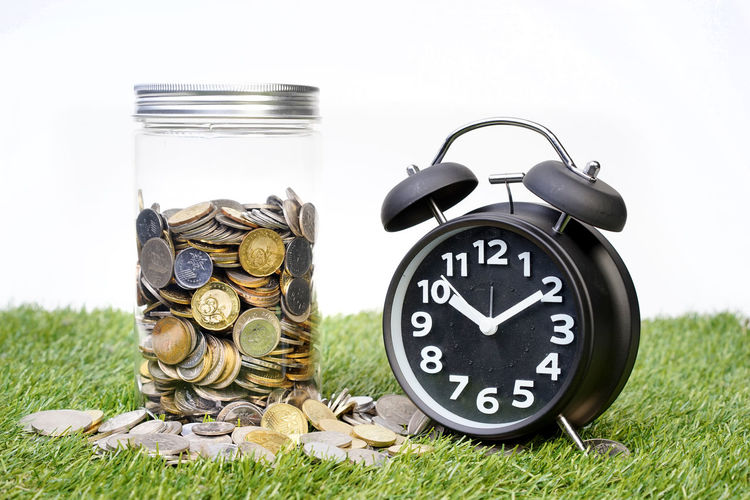 Money in a jar. Saving or investment concept. Economy Grass Growth Text Bank Concept Deposit Finance Fund Future Glass Growth Process Investment Jar Label Savings Wealth Wealth Management