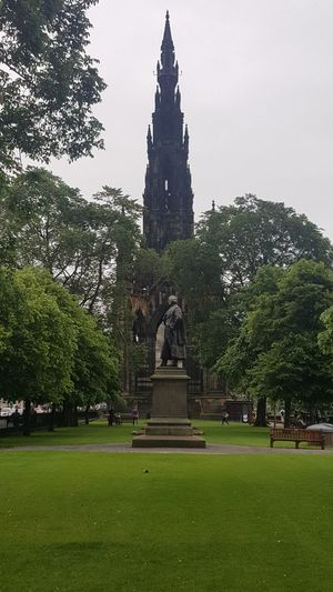 "The Scott Monument is a Victorian Gothic monument to Scottish author Sir Walter Scott. It is the largest monument to a writer in the world. It stands in Princes Street Gardens in Edinburgh, opposite the Jenners department store on Princes Street and near to Edinburgh Waverley Railway Station, which is named after Scott's Waverley novels. The tower is 200 feet 6 inches (61.11 m) high, and has a series of viewing platforms reached by a series of narrow spiral staircases giving panoramic views of central Edinburgh and its surroundings. The highest platform is reached by a total of 287 steps (those who climb the steps can obtain a certificate commemorating their achievement). It is built from Binny sandstone quarried near Ecclesmachan in West Lothian. In terms of its location, it is placed on axis with South St David Street, the main street leading off St Andrew Square to Princes Street, and is a focal point within that vista, its scale being large enough to totally screen the Old Town behind. As seen from the south side, Princes Street Gardens, its location appears more random, but it totally dominates the Eastern Section of the gardens, through a combination of its scale and elevated position relative to the sunken gardens. Following Scott's death in 1832, a competition was held to design a monument to him. An unlikely entrant went under the pseudonym ""John Morvo"", the name of the medieval architect ofMelrose Abbey. Morvo was in fact George Meikle Kemp, forty-five-year-old joiner, draftsman, and self-taught architect. Kemp had feared his lack of architectural qualifications and reputation would disqualify him, but his design (similar to an unsuccessful one he had earlier submitted for Glasgow Cathedral) was popular with the competition's judges, and in 1838 Kemp was awarded the contract to construct the monument. John Steell was commissioned to design a monumental statue of Scott to rest in the space between the tower's four columns. Steell's statue, made from white Carrara marble, shows Scott seated, resting from writing one of his works with a quill pen and his dog Maida by his side. The monument carries 64 figures (carried out in three phases) of characters from Scott's novels by a variety of Scots sculptors including, Alexander Handyside Ritchie, John Rhind, William Birnie Rhind, William Brodie, William Grant Stevenson, David Watson Stevenson, John Hutchison,George Anderson Lawson, Thomas Stuart Burnett, William Shirreffs, Andrew Currie, George Clark Stanton, Peter Slater, and two female representatives, Amelia Robertson Hill (who also made the statue of David Livingstone immediately east of the monument), who contributed three figures to the monument, and the otherwise unknown Katherine Anne Fraser Tytler. The foundation stone was laid on 15 August 1840. Following permission by an Act of Parliament (the Monument to Sir Walter Scott Act 1841 (4 & 5 Vict.) C A P. XV.), construction began in 1841 and ran for nearly four years. The tower was completed in the autumn of 1844, with Kemp's son placing the finial in August of the year. The total cost was just over £16,154. When the monument was inaugurated on 15 August 1846, George Meikle Kemp himself was absent; Kemp having fallen into the Union Canal while walking home from the site on the foggy evening of 6 March 1844 and drowned. In total (excluding Scott and his dog) there are 68 figurative statues on the monument of which 64 are visible from the ground. Four figures are placed above the final viewing gallery and are only visible by telephoto or (at a very distorted angle) from the viewing gallery itself. In addition, eight kneeling Druid figures support the final viewing gallery. There are 32 unfilled niches at higher level. Sixteen heads of Scottish poets and writers appear on the lower faces, at the top of the lower pilasters. The heads (anti-clockwise from the NW) represent: James Hogg; Robert Burns; Robert Fergusson; Allan Ramsay; George Buchanan; Sir David Lindsay; Robert Tannahill; Lord Byron; Tobias Smollett; James Beattie; James Thomson; John Home; Mary, Queen of Scots; King James I of Scotland; King James V of Scotland; and William Drummond of Hawthornden. In total, 93 persons are depicted, plus two dogs and a pig. In the early 1990s it was proposed that the stonework should be cleaned. There were views for and against cleaning and a scientific/geological investigation, including cleaning trials on samples of stone, was carried out. It was decided not to clean the stone due to the damage it would sustain. A restoration programme was undertaken involving replacing old repairs and damaged areas with Binny stone for which purpose the original quarry was re-opened. The fresh stonework contrasts with the smoke-darkened original. The overall cost of the restoration was £2.36 million and was funded by the Heritage Lottery Fund, Historic Scotland and the City of Edinburgh Council. The monument is now administered by the Culture and Sport division of the City of Edinburgh Council. The monument is featured prominently in the movie Cloud Atlas, as a location which the character Robert Frobisher frequents. Architecture Architecture & Statues Architecture Facade Architecture Photography Architecture_bw Architecture_collection Architecturelovers EyeEm Best Shots From My Point Of View Gothic Gothic Architecture Hidden Gems  Historical Monuments Medieval Portrait Princes Street Princes Street Gardens Scotland Scott Scott Monument Scottish Statue Victorian Victorian Architecture Walter Scott"