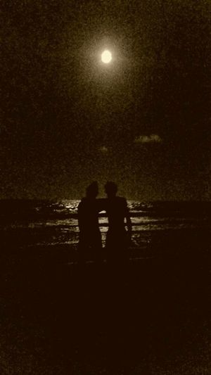 Two People Night Silhouette Beach Moon Sea Sand Moonlight Togetherness Outdoors Nature Couple - Relationship Illuminated Star - Space Women Men Beauty In Nature Adult Sky People