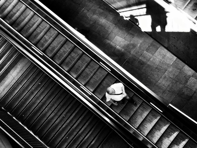 Blackandwhite Looking Down Escalators and People Watching Public Transportation Urban Life