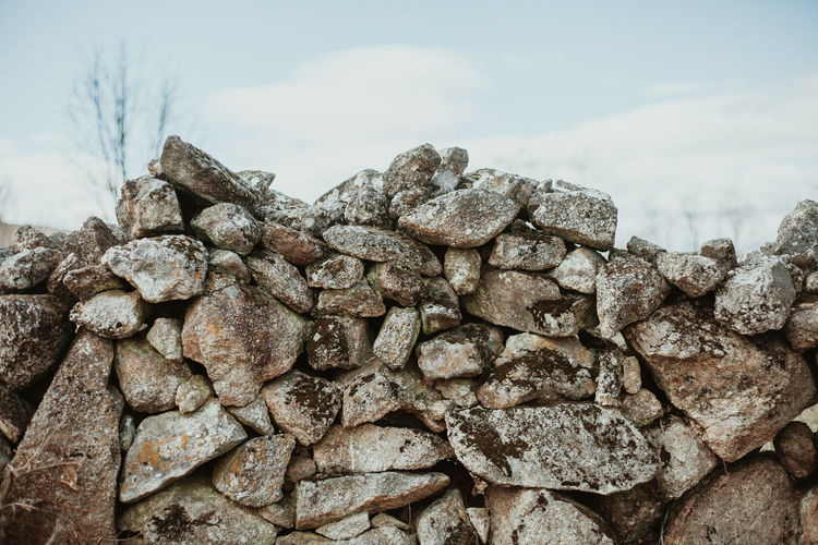 Wall Wall - Building Feature Walls Stone Wall Solid Rock Sky Day Textured  No People Rock - Object Nature Close-up Stone - Object Outdoors Rough Heap Stack Large Group Of Objects Pattern Abundance Stone Focus On Foreground Rural Scene