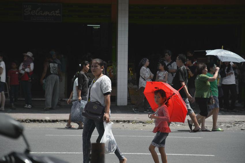 chinese new year celebration on mataram, lombok island, indonesia Street Photography Outdoors Nikonphotography Imlek 2016 Fun Cultures Enjoyment Chinese New Year Asian Culture Women Walking Umbrella Togetherness Street Streetphotography