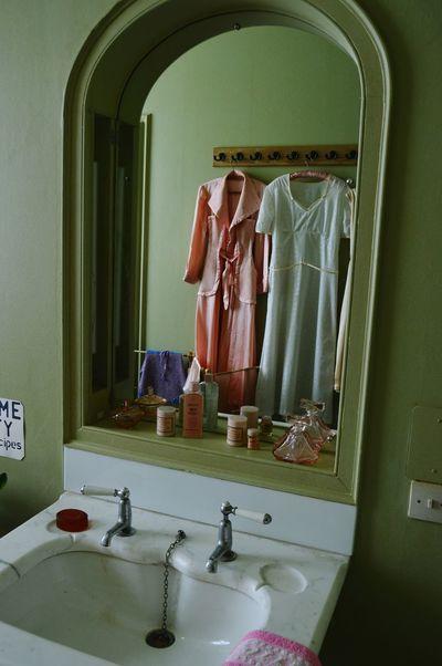 Bathroom 1940s Period Clothes Second World War Historical Building Reflection Mirror Perfume Toiletries Ladies Fashion
