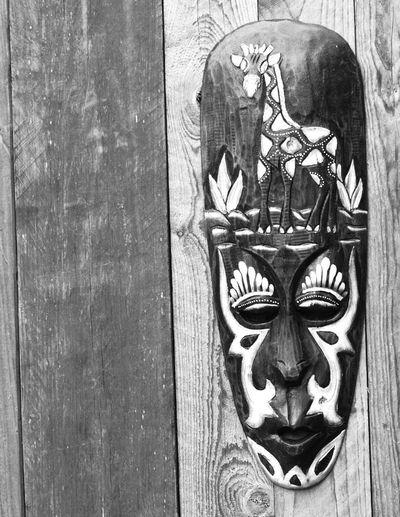 Close-up of door knocker on wall