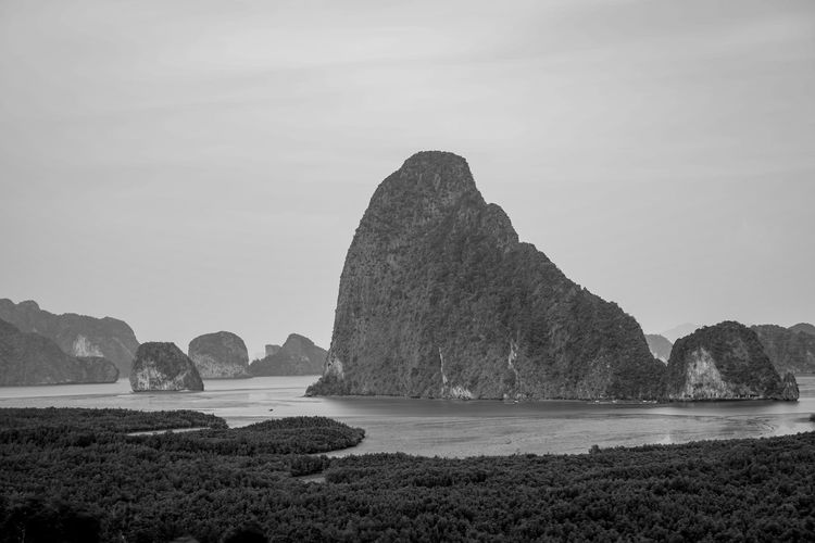 Water Sky Scenics - Nature Sea Beauty In Nature Tranquil Scene Tranquility Rock Nature Rock - Object Solid Land No People Rock Formation Beach Day Mountain Idyllic Non-urban Scene Outdoors Stack Rock Black And White Nature