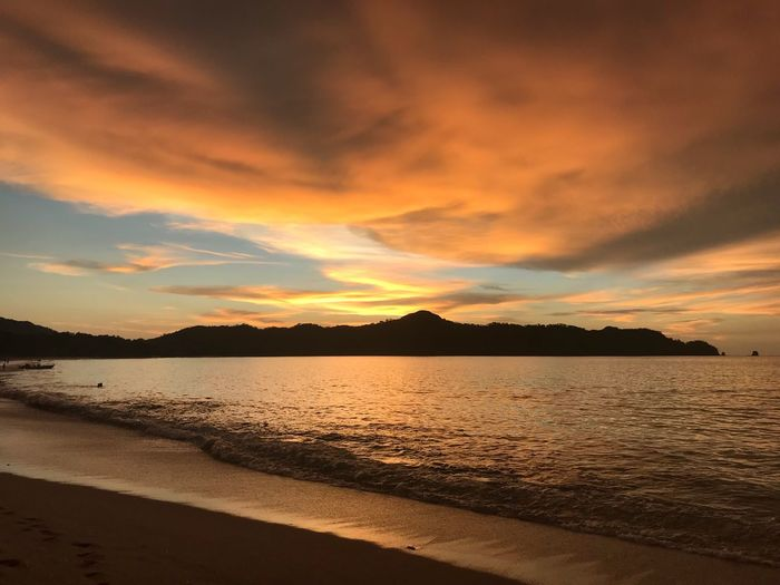 Sunset Scenics Beauty In Nature Nature Water Tranquility Tranquil Scene Sea Sky No People Outdoors Cloud - Sky Silhouette Beach Travel Destinations Mountain Day Horizon Over Water Costa Rica Dramatic Sky Romantic Sky