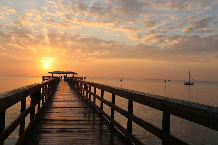 Pier Sunrise Sea Sunlight Beauty In Nature Sky Landscape Travel Destinations