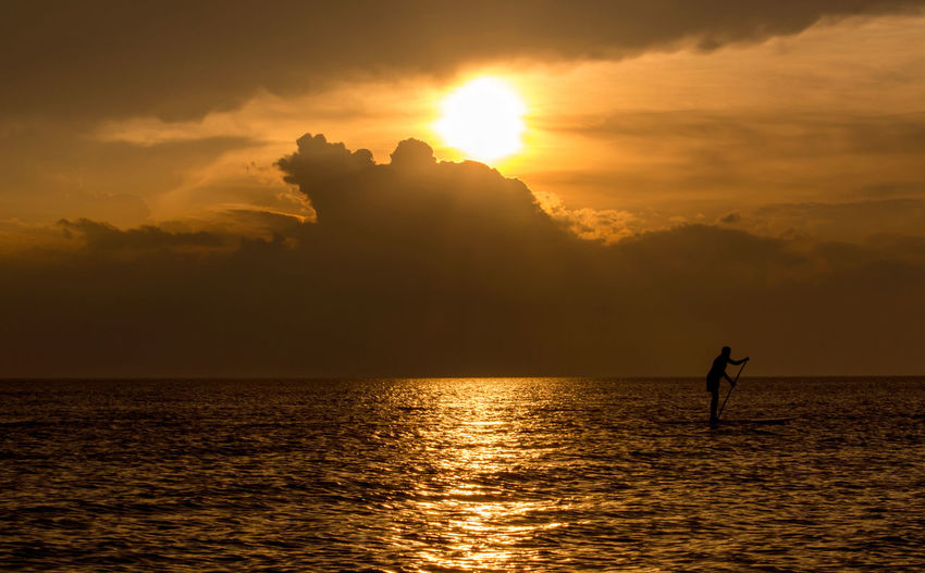 paddle boarder at sunset on Lake Michigan Sky Sunset Water Silhouette Scenics - Nature Beauty In Nature Waterfront Orange Color One Person Cloud - Sky Sun Reflection Nature Real People Sunlight Tranquility Men Tranquil Scene Horizon Over Water Outdoors Paddle Boarding Sport Lake Michigan USA Great Lakes Landscape Capture Tomorrow It's About The Journey My Best Photo