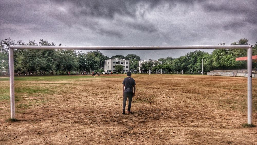 Waiting.. Football Soccer Field Soccer Player Soccer Stadium Football Game Day Outdoors Sky Real People MesmerizingView Sky And Clouds Goalkeeper Goalpost Goalkeepers