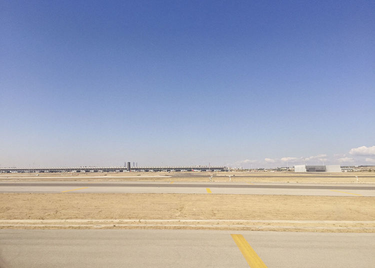 Airport Runway Against Sky During Sunny Day