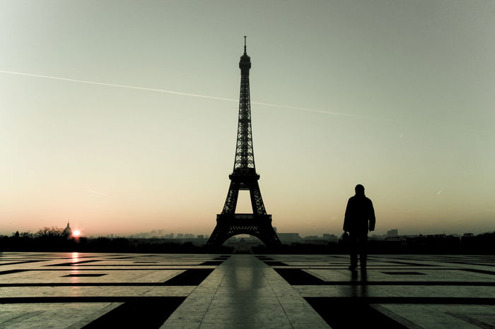Paris, Eiffel Tower, early morning. Winter time. Backlight, silhouette people. Dawn Dawn Of A New Day Eiffel Tower Famous Place International Landmark Morning Paris People Silhouette Sky Tour Eiffel Pastel Colors Panorama Travel Destinations Pastel Power Capital Cities  The Street Photographer - 2016 EyeEm Awards