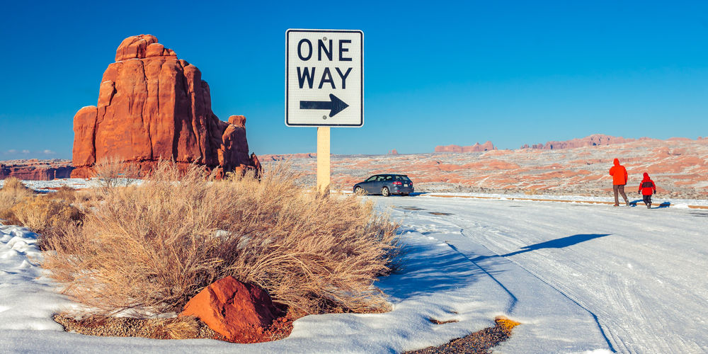 One Way Signboard On Snow Covered Landscape
