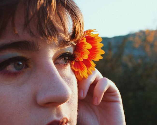 Colorful Analog Self Portrait VSCO EyeEm Selects Portrait Headshot Flower One Person Flowering Plant Real People Close-up Women Human Body Part Young Adult Nature Fragility Plant Lifestyles Vulnerability  Beauty In Nature Human Face Flower Head Outdoors