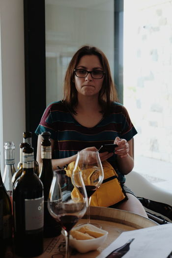 """""""Not bad"""" - Martyna looking at all those wines we got to taste // Eyeglasses  Food And Drink One Person Real People Bottle Indoors  Holding Refreshment Food Wineglass Young Adult Drink Young Women Wine Day Freshness Tasting Wine Wine Not FUJIFILM X-T10 XF18-55mmF2.8-4 R LM OIS F/3.6 Iso 400 via Fotofall"""