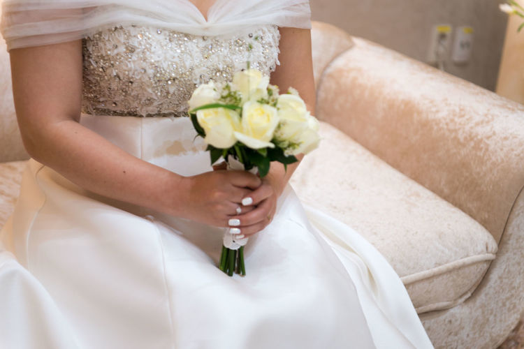 Flower Wedding Flowering Plant Bride Newlywed Wedding Dress Flower Arrangement Holding Midsection Adult Celebration Event Bouquet Plant Women Life Events One Person White Color Married Human Hand Hand Wife Wedding Ceremony Couple - Relationship Positive Emotion
