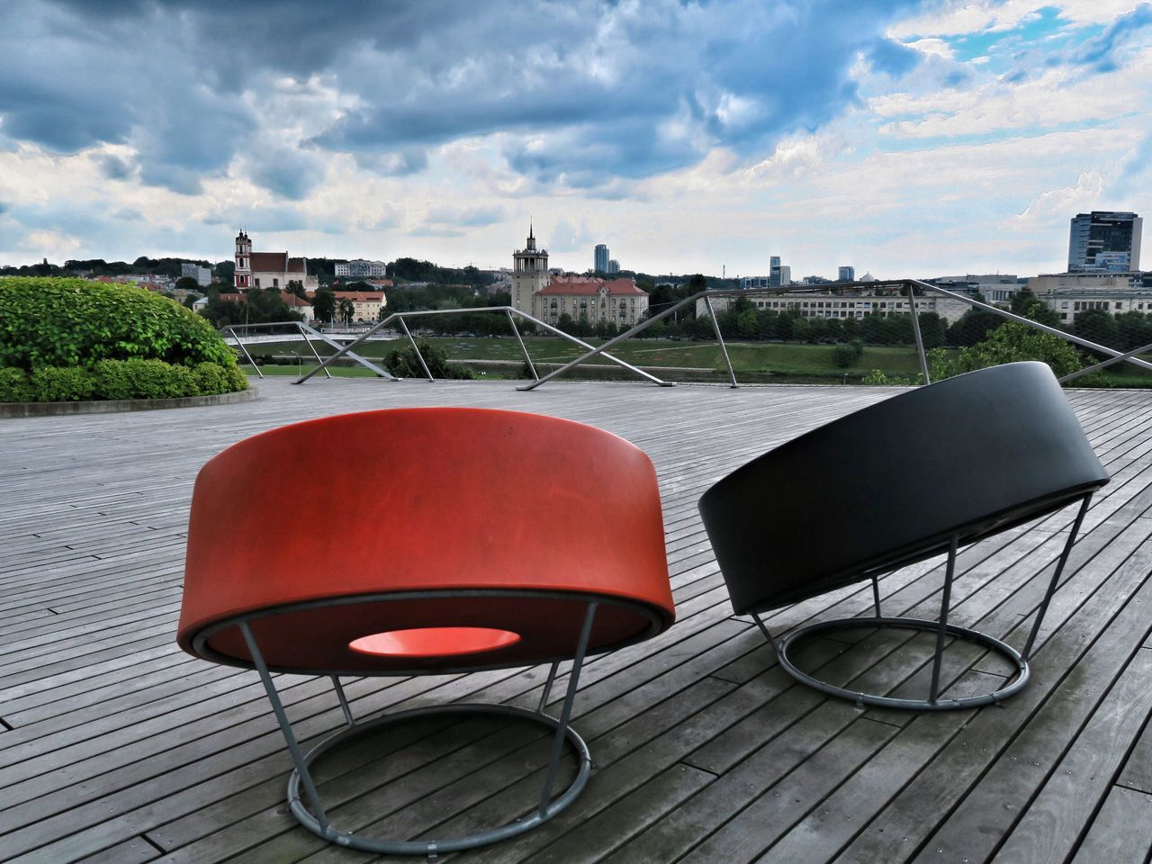 chair, sky, architecture, built structure, building exterior, terrace, outdoors, no people, day, cloud - sky, table, city, water, cityscape