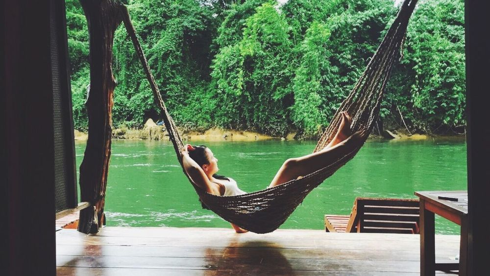 Real People Tree Lifestyles Full Length Water Hammock Nature One Person Relaxation Women Beauty In Nature Low Section Nature Thailand Storyformylife