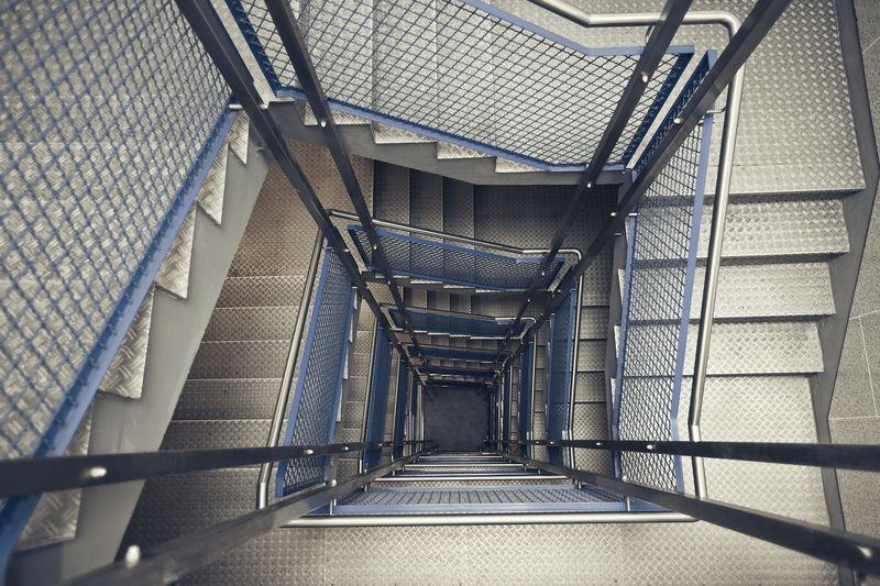 stairwell tunnel Architecture Built Structure Day Fire Escape Hand Rail High Angle View No People Outdoors Railing Silver  Staircase Stairs Stairway Stairwell Steps Steps And Staircases Tunnel Vison