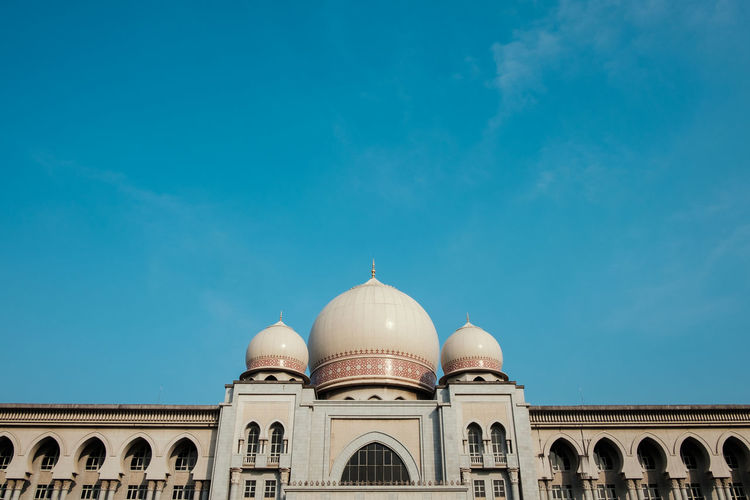 Low Angle View Of Dome Structure Against Blue Sky