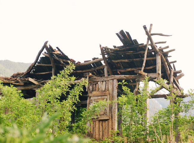 Falling down abandoned wooden house Abandoned Architecture Bad Condition Building Exterior Built Structure Calamity Country Decay Dilapidated Disaster Empty Falling Down Farm Front Grunge Haunted Home House Nature Old Ramshackle Ruins Rustic Spooky Wooden