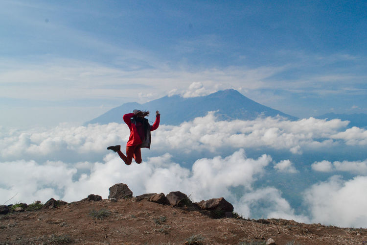 Sky Cloud - Sky One Person Leisure Activity Full Length Mid-air Lifestyles Mountain Beauty In Nature Real People Nature Scenics - Nature Freedom Land Adventure Men Day Tranquil Scene Human Arm Outdoors