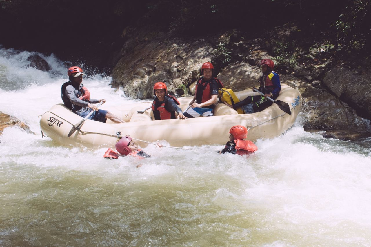 rafting, adventure, river, sports helmet, leisure activity, real people, inflatable raft, life jacket, water, helmet, fun, nature, men, sport, day, outdoors, vacations, motion, extreme sports, lifestyles, women, oar, nautical vessel, challenge, headwear, adult, people