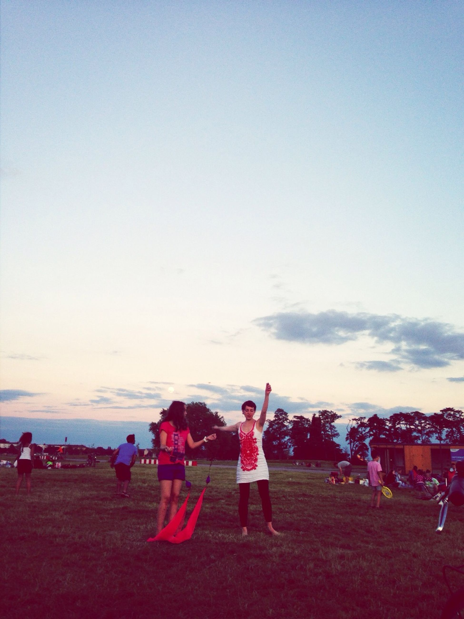 lifestyles, leisure activity, large group of people, sky, person, men, enjoyment, togetherness, full length, casual clothing, fun, copy space, field, childhood, girls, cloud - sky, landscape, mixed age range, grass