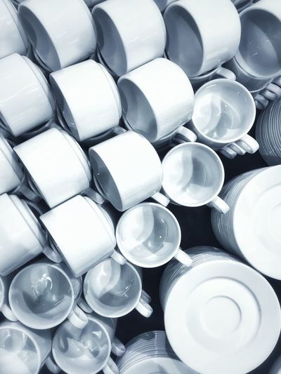 Full frame shot of cups and plates on table