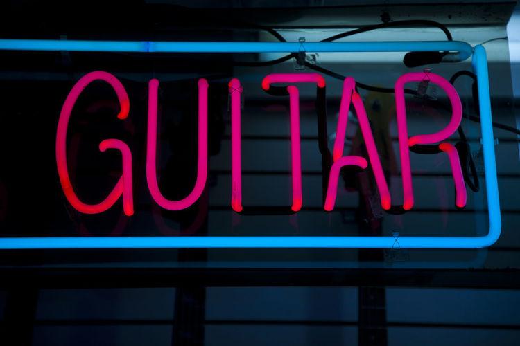 Rock music spirit, guitar, red neon sign