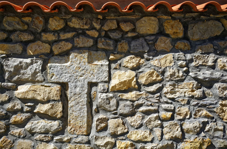 Stone cross in a wall Cantabria Cross Stone Cross Textured  Wall Backgrounds Religion Stone