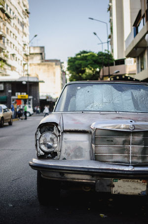 Chacao Mercedes Architecture Building Building Exterior Built Structure Car City Day Focus On Foreground Incidental People Land Vehicle Mode Of Transportation Motor Vehicle Outdoors Retro Styled Road Sky Stationary Street Streetphotography Transportation Vintage Car